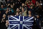 Home supporters reacting with delight to their team's opening goal in the second-half as West Bromwich Albion take on Leeds United in a SkyBet Championship fixture at the Hawthorns. Formed in 1878, the home team were relegated from the English Premier League the previous season and were aiming to close the gap on the visitors at the top of the table. Albion won the match 4-1 watched by a near-capacity crowd of 25,661.