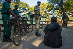 Arrested poacher with confiscated bicycles and snares by anti-poaching team, Kafue National Park, Zambia
