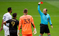 LOS ANGELES, CA - OCTOBER 25: Kevin Stott referee shows Giancarlo Gonzalez #21 of the Los Angeles Galaxy a red card during a game between Los Angeles Galaxy and Los Angeles FC at Banc of California Stadium on October 25, 2020 in Los Angeles, California.