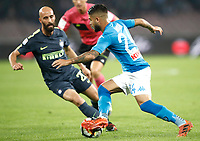Calcio, Serie A: Napoli, stadio San Paolo, 21 ottobre 2017.<br /> Napoli's Lorenzo Insigne (r) in action with Inter's Borja Valero (l) during the Italian Serie A football match between Napoli and Inter at Napoli's San Paolo stadium, October 21, 2017.<br /> UPDATE IMAGES PRESS/Isabella Bonotto