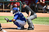 Julian Leon (34) of the Ogden Raptors behind the plate with home plate umpire Ryan Powers during the game against the Idaho Falls Chukars in Pioneer League action at Lindquist Field on July 27, 2014 in Ogden, Utah.  (Stephen Smith/Four Seam Images)