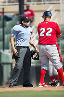 Home plate umpire David Martinez listens as Lakewood BlueClaws manager Shawn Williams (22) argues a call at home plate during the game against the Kannapolis Intimidators at Kannapolis Intimidators Stadium on May 8, 2016 in Kannapolis, North Carolina.  The Intimidators defeated the BlueClaws 3-2.  (Brian Westerholt/Four Seam Images)