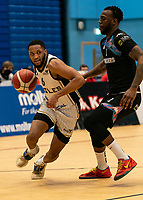 Cortez Edwards of Newcastle Eagles drives past Martelle McLemore of Surrey Scorchers during the BBL Championship match between Surrey Scorchers and Newcastle Eagles at Surrey Sports Park, Guildford, England on 20 March 2021. Photo by Liam McAvoy.