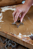 Madeleine Lee cutting dough into star shapes for Christmas cookies