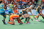 The Hague, Netherlands, June 14: Ellen Hoog #19 of The Netherlands tries to score as Kirstin Dwyer #6 of Australia and Jodie Kenny #7 of Australia try to block the shot during the field hockey gold medal match (Women) between Australia and The Netherlands on June 14, 2014 during the World Cup 2014 at Kyocera Stadium in The Hague, Netherlands. Final score 2-0 (2-0)  (Photo by Dirk Markgraf / www.265-images.com) *** Local caption ***