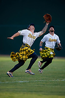Savannah Bananas first baseman Daniel Oberst (28) attempts to catch a shallow fly ball during a Coastal Plain League game against the Macon Bacon on July 15, 2020 at Grayson Stadium in Savannah, Georgia.  Savannah wore kilts for their St. Patrick's Day in July promotion.  (Mike Janes/Four Seam Images)