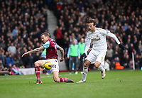 Barclays Premier League, West Ham United (red)V Swansea City Fc (white), Boelyn Ground, 02/02/13<br /> Pictured: Swans Striker Michu skips through the challenge of  Matt Taylor<br /> Picture by: Ben Wyeth / Athena Picture Agency<br /> info@athena-pictures.com