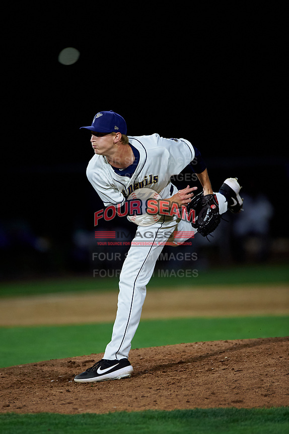 Tri-City Dust Devils relief pitcher Deacon Medders (24) follows through on his delivery during a Northwest League game against the Vancouver Canadians at Gesa Stadium on August 21, 2019 in Pasco, Washington. Vancouver defeated Tri-City 1-0. (Zachary Lucy/Four Seam Images)
