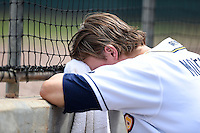 Montgomery Biscuits outfielder Taylor Motter (10) takes a break from the heat during a game against the Mississippi Braves on April 22, 2014 at Riverwalk Stadium in Montgomery, Alabama.  Mississippi defeated Montgomery 6-2.  (Mike Janes/Four Seam Images)