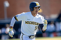 Michigan Wolverines outfielder Tito Flores (22) runs to first base during the NCAA baseball game against the Illinois Fighting Illini on March 20, 2021 at Fisher Stadium in Ann Arbor, Michigan. Michigan won the game 8-1. (Andrew Woolley/Four Seam Images)