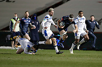 12th February 2021; AJ Bell Stadium, Salford, Lancashire, England; English Premiership Rugby, Sale Sharks versus Bath; Jono Ross (C) of Sale Sharks slips the tackle of  Ben Spencer of Bath Rugby