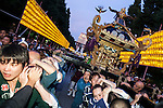 Participants carry on their shoulders a portable shrine between the lanterns lining the path to the Yasukuni Shrine during the annual ''Mitama Festival'' on July, 13, 2015, Tokyo, Japan. Over 30,000 lanterns line the entrance to the shrine to help spirits find their way during the annual celebration for the spirits of ancestors. The festival is held from July 13th to 16th. (Photo by Rodrigo Reyes Marin/AFLO)