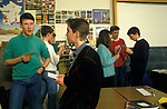 Comprehensive Secondary School 1990s UK. Pupils boys and girls preparing for GCSE dressed informally end. Sheffield UK Yorkshire 1990. They are practicing their French oral exam using cards for  prompts.
