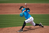 Miami Marlins pitcher Adam Cimber (90) during a Major League Spring Training game against the Houston Astros on March 21, 2021 at Roger Dean Stadium in Jupiter, Florida.  (Mike Janes/Four Seam Images)