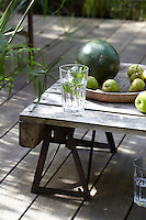 The coffee table on the terrace has been made from a palette cut in half and placed on a low trestle