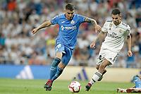 Real Madrid's Dani Ceballos (r) and Getafe CF's Mauro Arambarri during La Liga match. August 19,2018.  *** Local Caption *** © pixathlon<br /> Contact: +49-40-22 63 02 60 , info@pixathlon.de