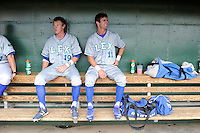 Outfielder Bubba Starling (11) of the Lexington Legends, right, sits dugout with Fred Ford (19), left, before a game against the Greenville Drive on Sunday, July 21, 2013, at Fluor Field at the West End in Greenville, South Carolina. At left is Fred Ford (19). Starling is the No. 2 prospect of the Kansas City Royals and was the No. 5 overall pick in the first round of the 2011 First-year Player Draft. Lexington won, 2-0. (Tom Priddy/Four Seam Images)