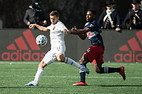 FOXBOROUGH, MA - MARCH 7: Przemyslaw Frankowski #11 of Chicago Fire prepares to pass a ball with DeJuan Jones #24 of New England Revolution in pursuit during a game between Chicago Fire and New England Revolution at Gillette Stadium on March 7, 2020 in Foxborough, Massachusetts.