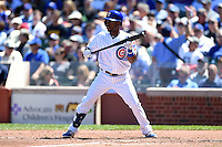 Chicago Cubs outfielder Arismendy Alcantara (7) squares to bunt during a game against the Milwaukee Brewers on August 14, 2014 at Wrigley Field in Chicago, Illinois.  Milwaukee defeated Chicago 6-2.  (Mike Janes/Four Seam Images)