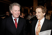 Jean Charest, Quebec Premier (L)<br /> Jesus Carles  de Vilallonga (R).<br /> <br /> Internationally  know artist J C de Vilallonga donated recent painting for a benefit sales for tyhose with menyal disabilities, held at Parisian laundry in <br /> Montreal, canada<br /> <br /> photo : (c) 2005 Images Distribution