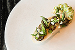 May 8, 2015. Chapel Hill, North Carolina.<br />  The Green Garlic and Chicken Roulade at [ONE] Restaurant consists of morels, asparagus, gouda, toast and pickle jus.<br />   [ONE] Restaurant, located in Chapel Hill's Meadowmont development, specializes in contemporary cuisine, with an emphasis on flavor pairings and unique ingredients. <br />  Outsiders tend to lump Chapel Hill with nearby Durham, but the more sensible pairing is with Carrboro, the adjacent town that was once a mere offshoot known as West End. Even today the transition from Chapel Hill, anchored by North Carolina''s flagship public university, into downtown Carrboro is virtually seamless.