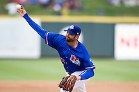 Round Rock Express pitcher Justin Germano (21) delivers a pitch to the plate during the first game of a Pacific Coast League doubleheader against the Memphis Redbirds on August 3, 2014 at the Dell Diamond in Round Rock, Texas. The Redbirds defeated the Express 4-0. (Andrew Woolley/Four Seam Images)