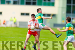Rob Ó Sé from An Ghaeltacht takes the mark despite the challenge from Jack Myers of John Mitchels in the Intermediate Football Championship.