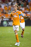 """Houston Dynamo midfielder Stuart Holden (22) leads the crowd in a song of """"Happy Birthday"""" to celebrate his penalty kick goal on his 24th birthday.  Houston Dynamo defeated D.C. United 4-3 at Robertson Stadium in Houston, TX on August 1, 2009."""