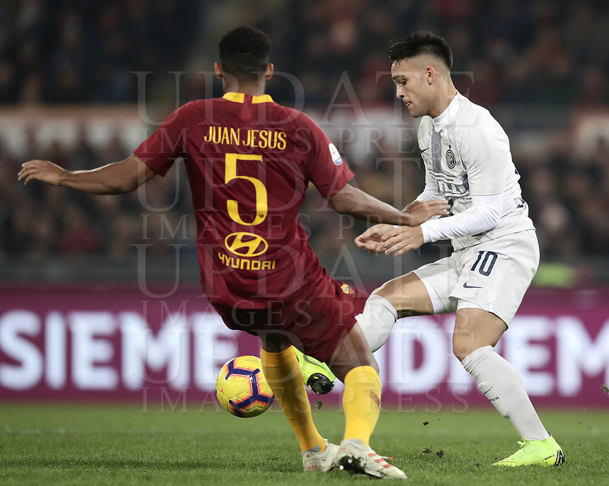 Football, Serie A: AS Roma - InterMilan, Olympic stadium, Rome, December 02, 2018. <br /> IInter's Javier Lautaro Martinez (r) in action with Roma's Juan Jesus (l) during the Italian Serie A football match between Roma and Inter at Rome's Olympic stadium, on December 02, 2018.<br /> UPDATE IMAGES PRESS/Isabella Bonotto