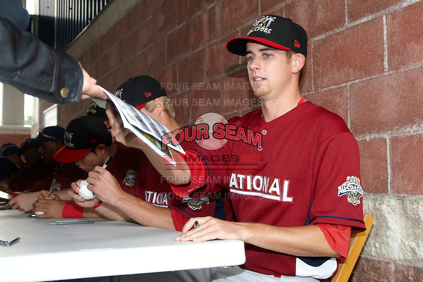 Batavia Muckdogs pitcher Tyler Melling #49 signs autographs before the NY-Penn League All-Star Game at Eastwood Field on August 14, 2012 in Niles, Ohio.  National League defeated the American League 8-1.  (Mike Janes/Four Seam Images)