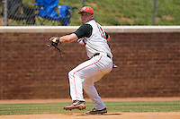 Third baseman Greg Hopkins #11 of the St. John's Red Storm makes a throw to first base against the Ole Miss Rebels at the Charlottesville Regional of the 2010 College World Series at Davenport Field on June 6, 2010, in Charlottesville, Virginia.  The Red Storm defeated the Rebels 20-16.  Photo by Brian Westerholt / Four Seam Images
