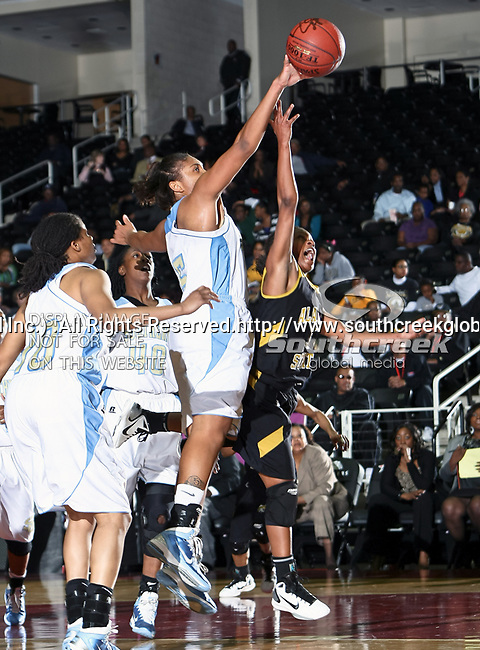 Southern Lady Jaguars guard Jamie Floyd (5) and Alabama State Hornets guard Tamara Waldington (3) in action during the SWAC Tournament game between the Southern Lady Jaguars and the Alabama State Hornets at the Special Events Center in Garland, Texas. Southern defeats Alabama State 58 to 39.