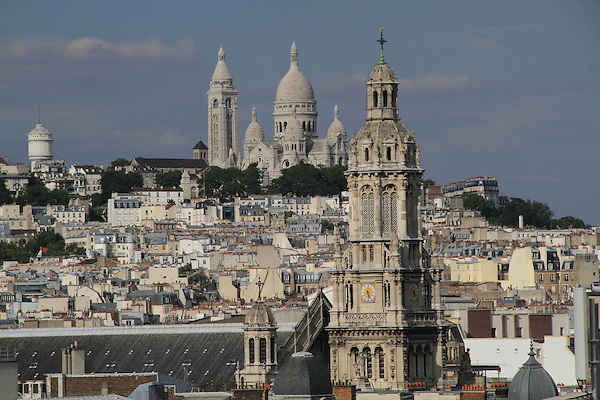 France, Paris.  <br /> It's worth finding public locations like museums, restaurants and parking garages that offer accessible views of the city. <br /> Here, the restaurant atop Printemps department store provides a compelling vista towards Sacre Coeur Bascillica in Paris.