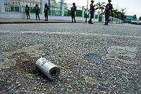 An empty tear gas cartridge left on the street after a violent riot in front of the Presidential Palace in Port-au-Prince, Haiti. The United Nations Stabilization Mission In Haiti (MINUSTAH) is a peacekeeping mission that has been installed in Haiti in 2004 by the United Nations. In spite of the undoubted efforts that have been made by the UN, MINUSTAH soldiers became a symbol of the occupation and therefore they are generally not welcomed by the Haitian population.
