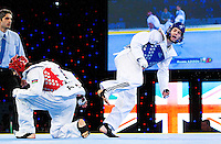 05 MAY 2012 - MANCHESTER, GBR - Aaron Cook (GBR) of Great Britain (right in blue) steps away after an attack on Ramin Azizov (AZE) (left in red) of Azerbaijan during the men's 2012 European Taekwondo Championships -80kg final at Sportcity in Manchester, Great Britain (PHOTO (C) 2012 NIGEL FARROW)