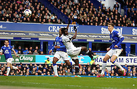 Pictured: Wilfried Bony of Swansea (C) heads the ball at goal. Saturday 22 March 2014<br /> Re: Barclay's Premier League, Everton v Swansea City FC at Goodison Park, Liverpool, UK.