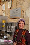Judea, Hebron Mountain. A volunteer at a coffee corner in Hebron