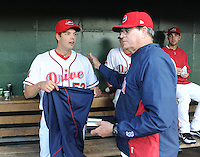 Left handed pitcher Rich Hill (53) of the Boston Red Sox is congratulated by pitching coach Dick Such (44) following a Major League rehab assignment with the Greenville Drive in a game against the Lakewood BlueClaws on April 7, 2012, at Fluor Field at the West End in Greenville, South Carolina. (Tom Priddy/Four Seam Images).