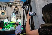 A woman captures with her cell phone the image of the Virgin of Carmen was put on display outside the church so that citizens could see it from a distance, during an atypical celebration and celebration of Our Lady of Carmen in the Virgin's chapel del Carmen due to the covid19 pandemic on July 16 in Hermosillo Mexico.<br /> (Photo: Luis Gutierrez / NortePhoto.com)<br /> una mujer capta con us celular la imagen de la virgen del Carmen fue puesta en exibicion en el exterior de la iglecia para que ciudadanos la puderan ver a la distacia , durante una celebración atipica y festejo a  Nuestra Señora del Carmen en la capilla de la virgen del Carmen por la pandemia de covid19 el 16 julio en Hermosillo Mexico.<br /> (Photo: Luis Gutierrez / NortePhoto.com) .<br /> agua bendita