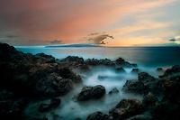 Sunset and rocky coastline. Maui, Hawaii