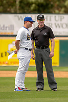 Rancho Cucamonga Quakes Manager Drew Saylor discussing the call with Base umpire Darius Ghani during the game against the Visalia Rawhide at LoanMart Field on May 13, 2018 in Rancho Cucamonga, California. The Quakes defeated the Rawhide 3-2.  (Donn Parris/Four Seam Images)