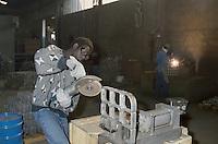 - African immigrant working in a foundry....- immigrato africano al lavoro in fonderia