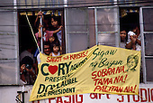 """Manila, Philippines<br /> February 1986<br /> <br /> Corazon Aquino campaigning for President of the Philippines in 1986.<br /> <br /> Corazon Aquino was born into one of the wealthiest families in the Philippines, Mrs. Aquino began her political education by playing the dutiful wife as the political career of her husband, Benigno Aquino Jr., expanded. In less than 20 years he emerged as one of the chief potential rivals of Mr. Marcos, who was then president. When Mr. Marcos declared martial law in 1972, her husband was arrested and imprisoned for seven years. He was assassinated in 1983 after returning to the Philippines from a three-year exile in the United States. Mr. Marcos was widely blamed for the murder. It was at Mr. Aquino's funeral that Mrs. Aquino, became a national symbol, demonstrating the dignity and composure that would characterize her most difficult moments as president. <br /> <br /> Mrs. Aquino came to power through what amounted to popular acclaim -- what the Philippino people called """"people power"""" -- expressed by huge crowds that gathered in support of her. Her popularity reached its peak during her presidential campaign against Mr. Marcos in January 1986, when she was surrounded by enthusiastic crowds chanting, """"Cory! Cory! Cory!'""""<br /> <br /> Her act of knocking down a dictator and bringing democracy to the Philippines was a high point in the country's modern history, and it offered a model for nonviolent uprisings that has been repeated often in other countries.<br /> <br /> Mrs. Aquino, was often criticized as an indecisive and ineffectual leader. But she combined passivity and stubbornness and an unexpected shrewdness to hold firm against powerful opponents from both the right and the left, and one of her greatest accomplishments as president was fending off a half dozen coup attempts. <br /> <br /> The restoration of democracy, and the transition to a new president, were Mrs. Aquino's prime legacies. Yet she led demonstrations against all"""