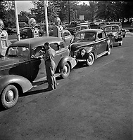 Morning of July 21st, the last day before stricter gas rationing went into effect, cars were parked in front of gas stations long before they opened, waiting to fill their tanks. Washington D.C., 1942.<br /> <br /> Photo by Marjory Collins.