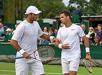 London, England, 30 june, 2016, Tennis, Wimbledon, Men's doubles: Horacia Tacau (ROU) and his partner Jean-Julien Rojer (NED) (R)<br /> Photo: Henk Koster/tennisimages.com