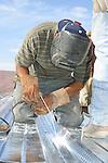Welder at work on roof<br /> (1)