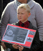 Pictured: A young boy with an album with pictures from the time at the Memorial Garden in Aberfan Friday 21 October 2016<br /> Re: Wales has fallen silent as the country remembered the Aberfan disaster 50 years ago.<br /> On 21 October 1966, a mountain of coal waste slid down into a school and houses in the Welsh village, killing 144 people, including 116 children.<br /> A day of events to commemorate the disaster included a service at Aberfan Cemetery at 9:15am on Friday.<br /> Prince Charles is visiting Aberfan memorial garden before unveiling a plaque in memory of the victims.<br /> He will also attend a reception with the families of some of those who lost their lives, before signing a book of remembrance.