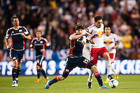 Stephen McCarthy (15) of the New England Revolution challenges Fabian Espindola (9) of the New York Red Bulls. The New York Red Bulls defeated the New England Revolution 4-1 during a Major League Soccer (MLS) match at Red Bull Arena in Harrison, NJ, on March 20, 2013.