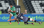 Connacht centre Bundee Aki skips past Ospreys number 8 Ieuan Jones.<br /> Guiness Pro12<br /> Ospreys v Connacht<br /> Liberty Stadium<br /> 31.10.14<br /> ©Steve Pope-SPORTINGWALES