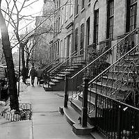 Person walking down Greenwich Village sidewalk<br />